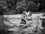 kissing on a fence