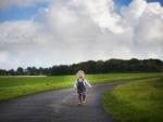 Child running down road