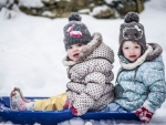 toddler girls sledging