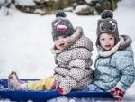 toddler girls sledging