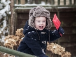 toddler playing in snow