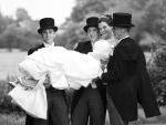 Groomsmen carrying bride