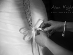 tying wedding dress